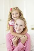 foto of cuddle  - Mother And Daughter Having Cuddle Together At Home - JPG