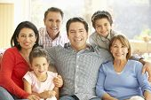 picture of extend  - Portrait Of Extended Hispanic Family Relaxing At Home - JPG
