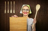 stock photo of ladle  - Funny rural woman cook holding ladle and chopping shim close - JPG