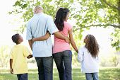 foto of stroll  - Young African American Family Enjoying Walk In Park - JPG