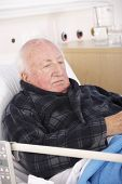 stock photo of hospital gown  - Senior man in hospital bed - JPG