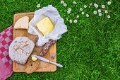 picture of cheese platter  - picnic board of bread butter cheese and sausage - JPG
