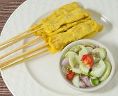 foto of sate  - Food and Cuisine Delicious Grilled Pork Satay on Bamboo Skewer Served with Cucumber Salad - JPG