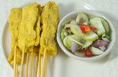 image of sate  - Food and Cuisine Grilled Pork Satay on Bamboo Stick Served with Cucumber Salad - JPG