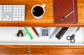 stock photo of black-cherry  - Cherry wood desktop with computer keyboard black coffee executive notepad and pen - JPG