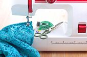 pic of sewing  - Sewing machine and sewing accessories on wooden table - JPG