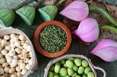 pic of seed  - Collection of lotus pink lotus flower green seed white lotus seed in fresh and dry herbal tea of this flora with amazing abstract concept in vibrant color this food make healthy good sleep - JPG