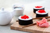 picture of chopsticks  - Sushi rolls with ginger - JPG