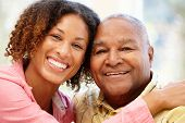 image of granddaughters  - Senior African American man and granddaughter - JPG