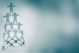 stock photo of human pyramid  - Human team pyramid on blue background - JPG