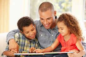 stock photo of father child  - Father reading to children - JPG