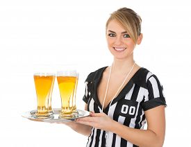 pic of referee  - Young Female Referee Holding Tray With Glass Of Beer Over White Background - JPG