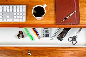 foto of black-cherry  - Cherry wood desktop with computer keyboard black coffee executive notepad and pen - JPG