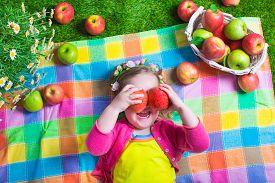 pic of healthy eating girl  - Child eating apple - JPG