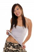 Young Asian American Teen Girl Smiling Holding Up Shirt
