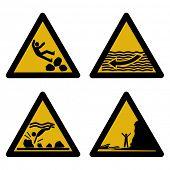 stock photo of slip hazard  - assorted beach hazard signs slippery rocks strong currents tides - JPG