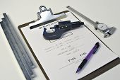 stock photo of micrometer  - various components involved in the quality control process - JPG