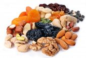 stock photo of dry fruit  - Groups of various kinds of dried fruits on white background - JPG