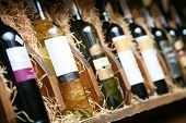 stock photo of liquor bottle  - Closeup shot of wineshelf - JPG