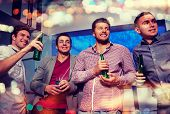 nightlife, party, friendship, leisure and people concept - group of smiling male friends with beer b poster