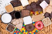 Food containing sugar. Too much sugar in diet causes obesity, diabetes and other health problems poster