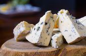 stock photo of penicillium  - A cheese platter featuring blue vein and camembert cheeses - JPG