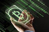 business, cryptocurrency and future technology concept - close up of hand with virtual bitcoin symbo poster