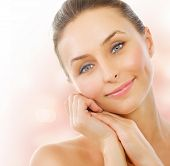stock photo of middle-age  - Beautiful Healthy Woman touching her skin - JPG