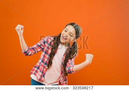poster of Celebrating Success. Happy Childrens Day. Childhood Happiness. Little Girl Orange Background. Kid Fa