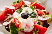 Exquisite serving salad of fresh vegetables, ricotta cheese and fragrant herbs on white restaurant p poster
