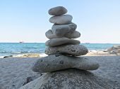Zen Stone Stack Near The Sea. Harmony, Balance And Simplicity Concept. Poise Pebbles, Zen Sculpture, poster
