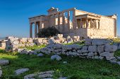 Ancient  Erechtheion Temple With Caryatid Porch On The Acropolis Near Parthenon, Athens, Greece. poster