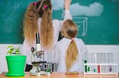 Biology Concept. Microscope And Test Tubes On Table In Classroom. Kid Near School Chalkboard Backgro poster