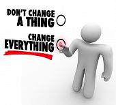 A man presses a button beside the words Change Everything to represent willingness to embrace change