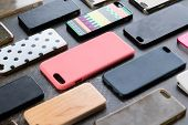 Pile Of Multicolored Plastic Back Covers For Mobile Phone. Choice Of Smart Phone Protector Accessori poster