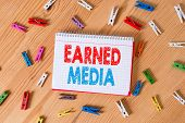 Conceptual Hand Writing Showing Earned Media. Business Photo Text Publicity Gained Through Promotion poster