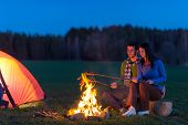 image of camper  - Camping night couple cook by campfire backpack in romantic countryside - JPG