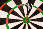 stock photo of fletching  - a dart in the bullseye - JPG