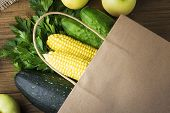 Paper Bag Vegetables And Fruit On The Dark Wooden Background With Copy Space Top View. poster
