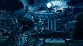 Mystery Creepy View Of Roman Forum At Night, Rome, Italy. Scary Gloomy Panorama Of Ruins Of Old Hous poster
