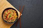 Vegetarian Schezwan Noodles Or Vegetable Hakka Noodles Or Chow Mein In Black Bowl At Dark Background poster