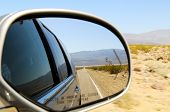 image of car-window  - Straight Road Reflection in car mirror Nevada USA - JPG