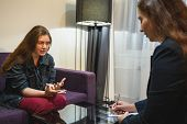 Psychologist Or Psychotherapist Doctor Consults Young Woman Patient On Therapy Session Or Counsels O poster