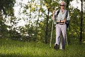 Seniors Sports And Healthy Lifestyle Concepts. Mature Caucasian Woman Having Fitness Nordic Walking  poster