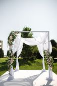 Beautiful Outgoing Wedding Set Up. Jewish Hupa On Romantic Wedding Ceremony , Wedding Outdoor On The poster