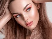 Portrait of a beautiful woman with a coral color makeup. Attractive blonde  girl with  bright fashio poster