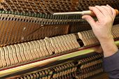 stock photo of mozart  - Piano tuning process - JPG