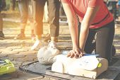 Asian Female Or Runner Woman Training Cpr Demonstrating Class In Park By Put Hands And Interlock Fin poster
