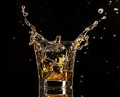 image of neat  - Glass of whiskey with splash - JPG