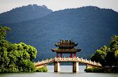 image of rebuilt  - a very famous pavilion bridge-yu dai qiao (jade belt) - in west lake, hangzhou, china was built in song dynasty and rebuilt in qing dynasty